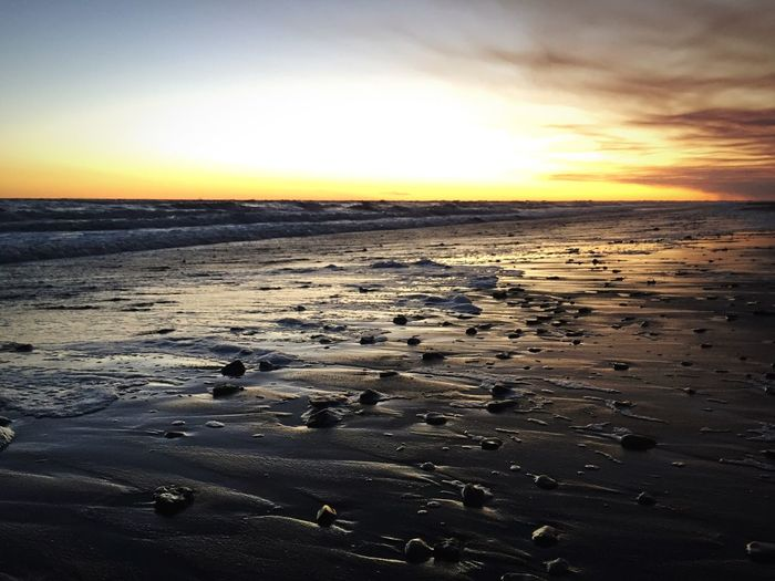 Sunset Sunset Beach Nature Beauty In Nature Sea Scenics Tranquility Sand Tranquil Scene Sky Horizon Over Water Outdoors Landscape Water No People Day