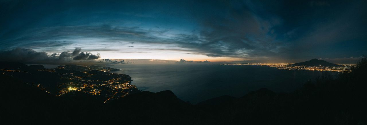 Panoramic View Of Amalfi Coast Against Cloudy Sky At Dusk