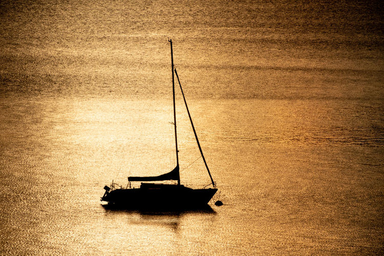 Sailboat on sea shore