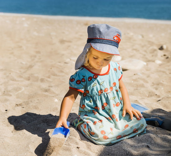 Full length of boy with toy on sand at beach