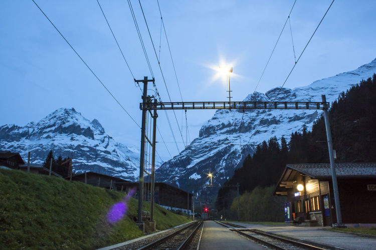Cable Transportation Mountain Electricity  Sky Power Line  Nature Direction Cold Temperature The Way Forward Mountain Range Snow Winter Road No People Diminishing Perspective Track Snowcapped Mountain Beauty In Nature