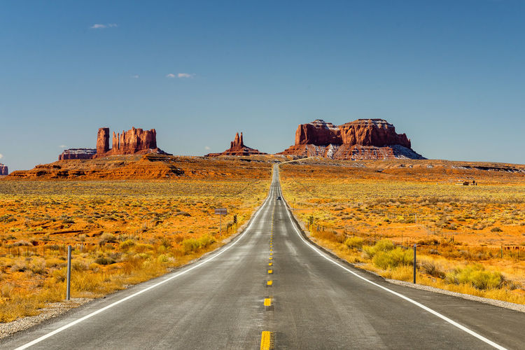 Monument Valley Beauty In Nature Clear Sky Day Landscape Nature No People Outdoors Road Rock Formation Scenics Sky The Way Forward Tranquility Travel Destinations