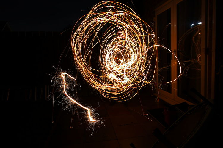 Testing out new ideas: Tonight sparklers more to come Illuminated Long Exposure Glowing Night Motion Blurred Motion No People Burning Arts Culture And Entertainment Sparks