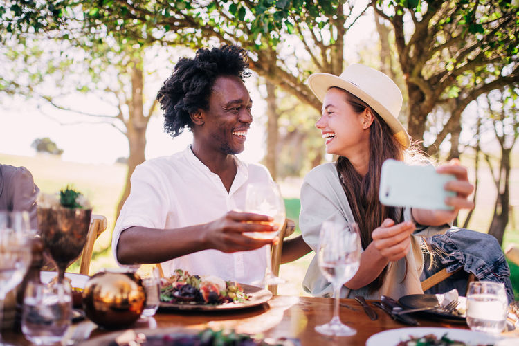 Food And Drink Togetherness Smiling Happiness Emotion Young Adult Adult Wineglass Drink Wine Alcohol Women Two People Young Women Table Glass Lifestyles Men Bonding Positive Emotion Couple - Relationship Drinking Red Wine Selfie Phone