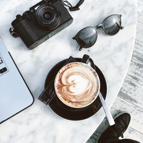 Palma de Mallorca, Spain Foot Lifestyle Black Shoes Cappuccino Coffee Coffee - Drink Cup Drink Flatlay Food And Drink Froth Art Frothy Drink Heart Shape High Angle View Hot Drink Laptop Latte Latte Art Marble Table Refreshment Still Life Sunglasses Table Vintage Camera White Marble