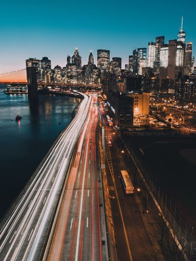 High Angle View Of Light Trails On Highway By East River In City