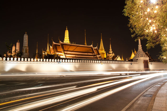 Light trails by Wat Phra Kaew, or 'The Temple of the Emerald Buddha'. It is the most important and most visited temple in Bangkok, Thailand. Bangkok Emerald Buddha Temple Light Light Trails Thailand Wat Phra Kaew Night Temple Traffic Lights