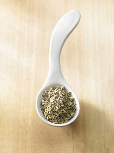 close up of the cumin seeds Spice Seed Cumin Ingredient Medicine Seasoning Scented Aromatic Food Food And Drink Indian Food Condiment Healthy Eating Dried Food Flavor No People Container Directly Above Top View Wood - Material Spoon