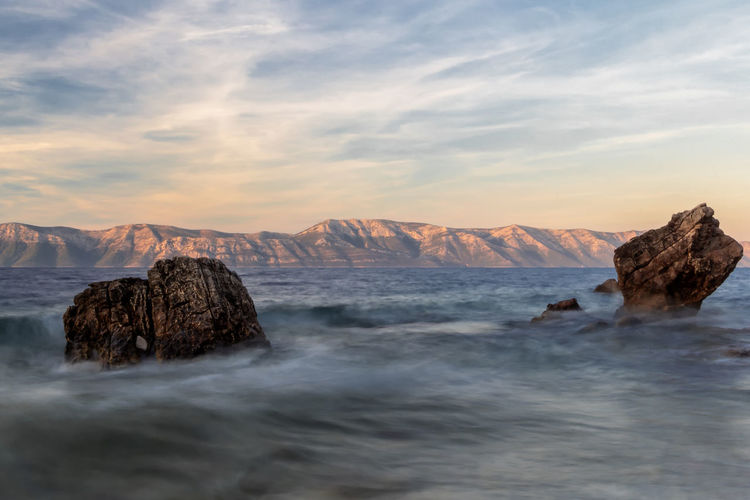 Beauty In Nature Cloud - Sky Flowing Water Idyllic Long Exposure Motion Mountain Mountain Range Nature No People Non-urban Scene Outdoors Power In Nature Rock Rock - Object Rock Formation Scenics - Nature Sea Sky Solid Sunset Tranquil Scene Tranquility Water Waterfront