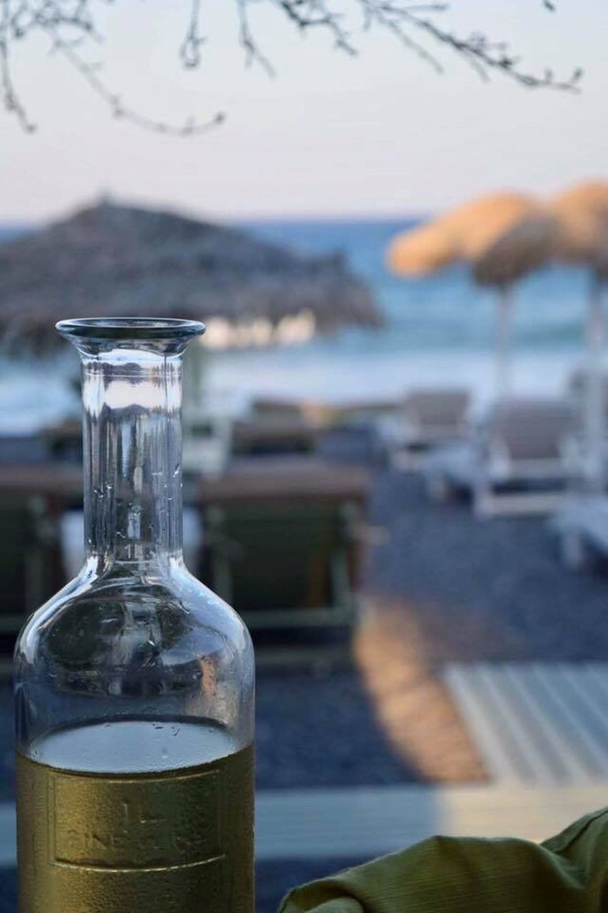 bottle, water, sea, focus on foreground, drink, no people, close-up, day, outdoors, nature, sky