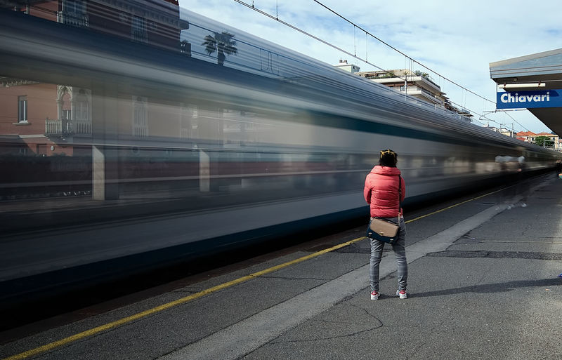 Waiting for the train Chiavari City City Life Longexposure Motion Movement Nd1000 On The Move One Person One Woman Only Only Women People Public Transportation Railroad Station Railroad Station Platform Railway Railway Station Rear View Speed Train Transportation Urban Life Waiting Waiting For A Train Waiting In Line