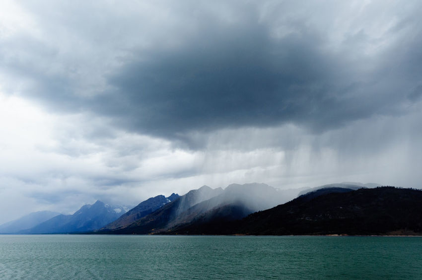 Storm over Lewis Lake, Yellowstone, Wyoming Beauty In Nature Cloud - Sky Day Lake Landscape Lewis Lake Mountain Mountain Range Nature No People Outdoors Range Scenics Sky Storm Storm Cloud Tranquil Scene Tranquility Water Waterfront Yellowstone