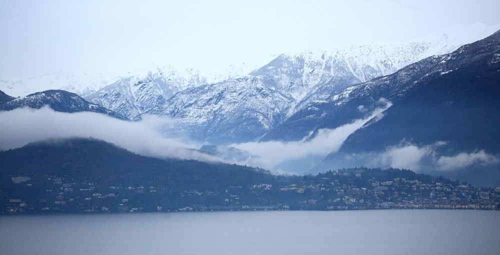 Ascona, Lago Maggiore, Switzerland Calmness Cold Temperature Feel The Journey Fog Over Mountains Fog Over The City Foggy Morning Idyllic Lake Shore Landscape Majestic Mountain Mountain Range Season  Snow Snowcapped Snowcapped Mountain Tranquility Winter