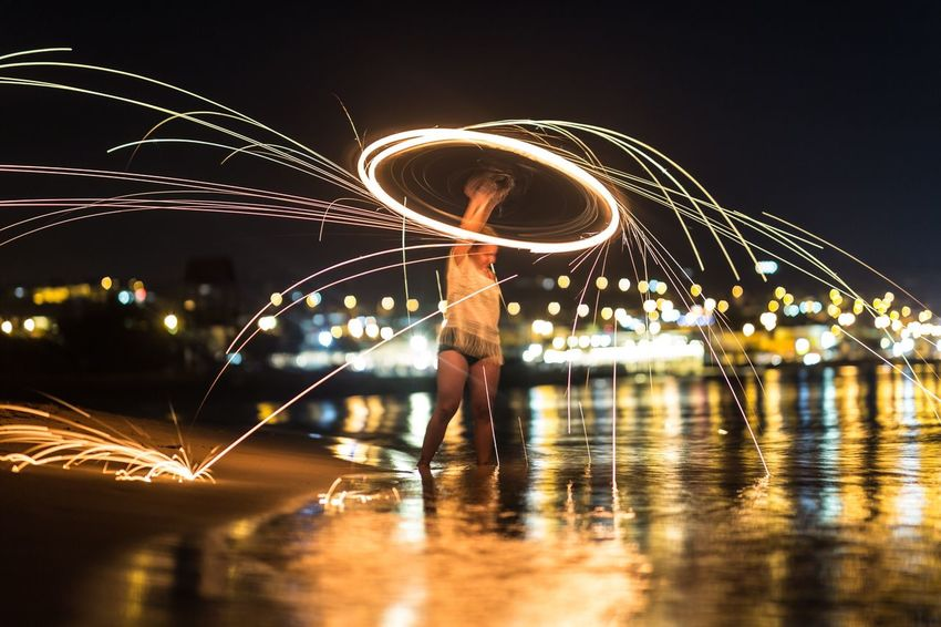 Night Long Exposure Illuminated Motion Real People One Person Wire Wool Light Painting Lifestyles Men Women Full Length Leisure Activity Standing Reflection Performance Firework - Man Made Object Water Outdoors Firework The Week On EyeEm