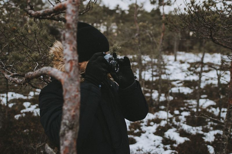Real People Photography Themes Photographing Winter Camera - Photographic Equipment Leisure Activity One Person Photographer Cold Temperature Digital Camera Technology Lifestyles Holding Digital Single-lens Reflex Camera Outdoors Bare Tree Day Nature Men Snow The Traveler - 2018 EyeEm Awards