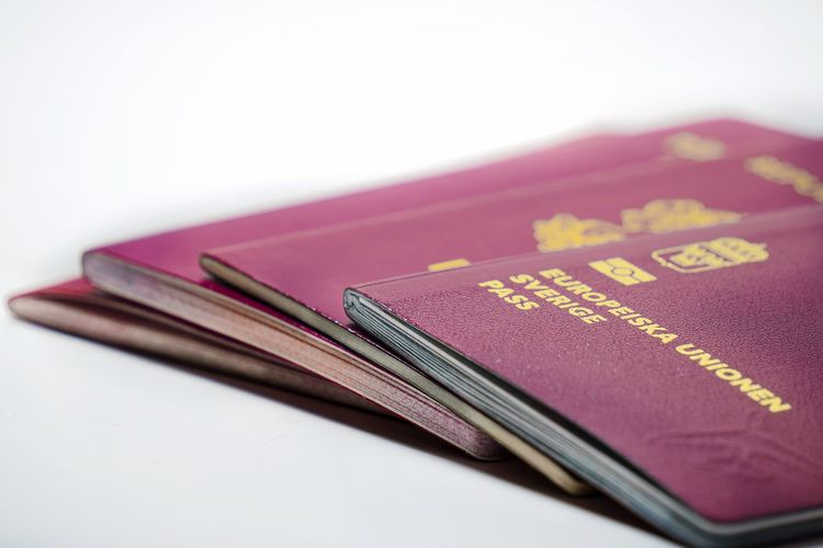 Close-up of passports against white background