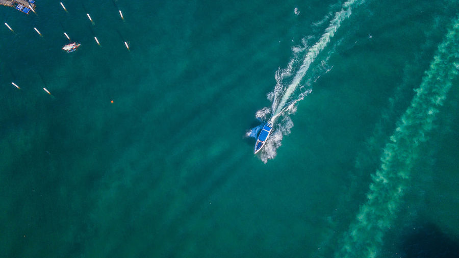 Water Sea Transportation Motion Nature Aerial View Mode Of Transportation Sport Day High Angle View on the move Turquoise Colored Outdoors Nautical Vessel Wake - Water Speed Wave Pattern Beauty In Nature No People Sailboat Pollution Luxury
