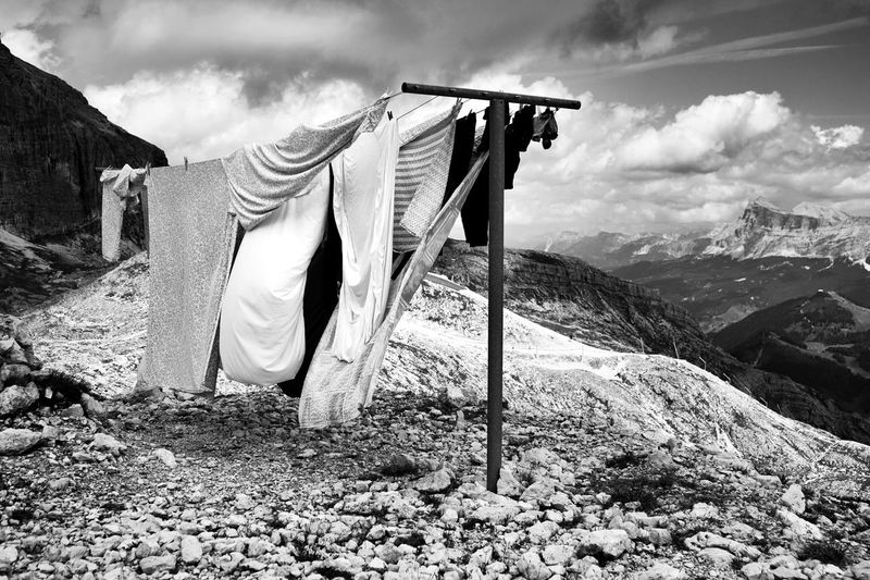 Clothes drying on clothesline against mountains
