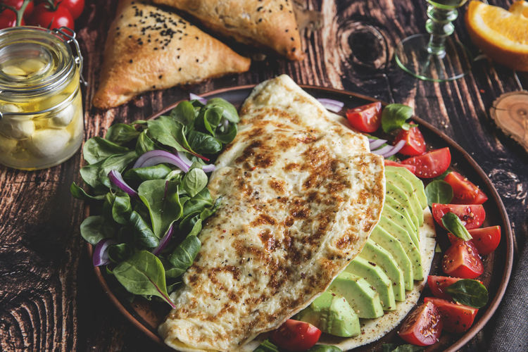 Omelet Avocado Cheese Dish Food And Drink Food Vegetable Freshness Fruit Healthy Eating Ready-to-eat Bread Indoors  Tomato Wellbeing High Angle View Table Still Life Salad Meal No People Serving Size Plate Meat Herb Vegetarian Food Snack