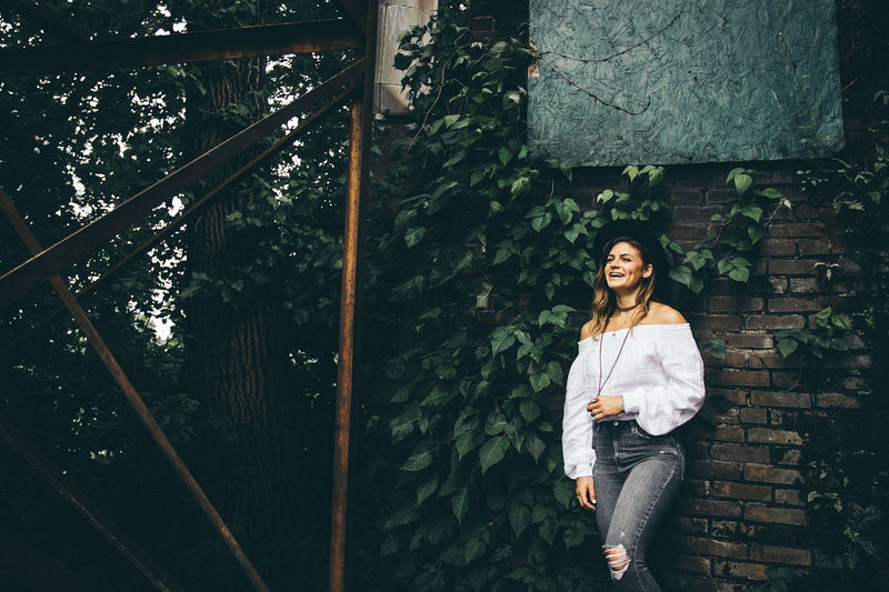 The Portraitist - 2017 EyeEm Awards Casual Clothing Only Women Adult Fashion Day Adults Only People One Person Young Adult One Woman Only Outdoors Confidence  Smiling Relaxation Young Women Attitude Portrait Happiness Cheerful Beautiful Woman Lifestyles Looking At Camera Fashion Model Adults Only