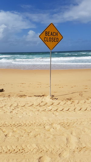 Beach Sea Sand Warning Sign Safety Text Horizon Over Water Danger Sky Communication Cloud - Sky Protection Water Tranquility No People Outdoors Beach Closed Road Sign Summer Day Vacations EyeEmNewHere
