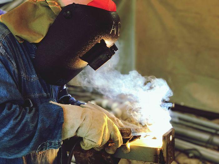 Close-up of man welding in workshop