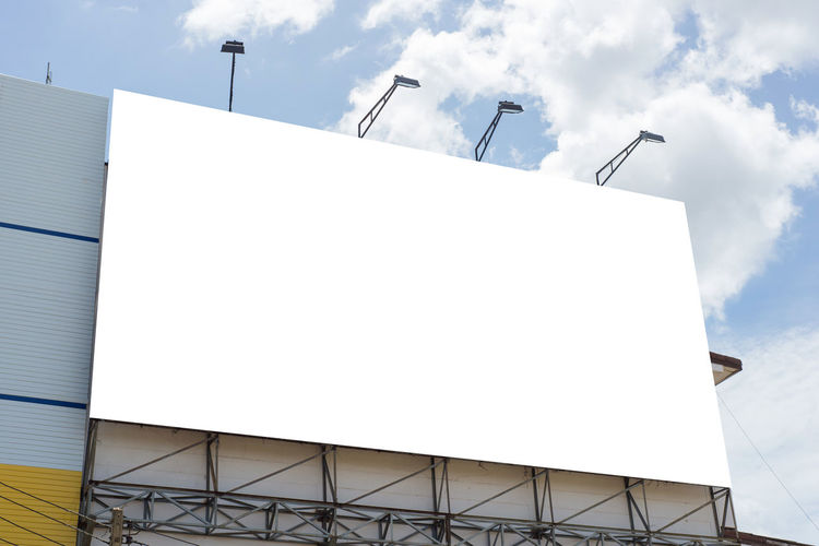Architecture Billboard Blank Building Building Exterior Built Structure City Cloud - Sky Communication Copy Space Day Low Angle View Nature No People Outdoors Sky Street Light Sunlight Tall - High Wall - Building Feature White Color