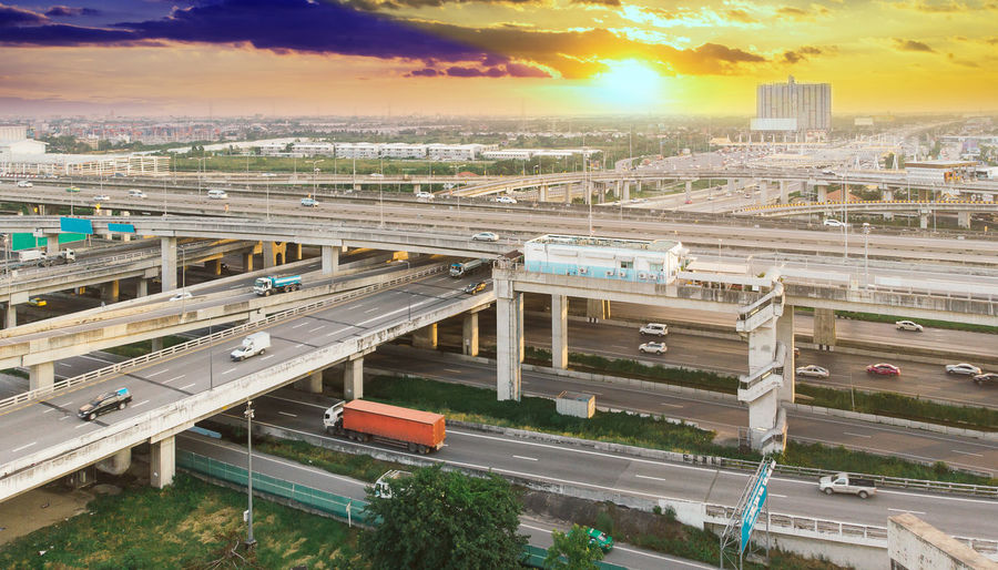 Transportation Architecture High Angle View Built Structure Sky Cloud - Sky Rail Transportation Train Train - Vehicle Building Exterior Mode Of Transportation City No People Public Transportation Land Vehicle Sunset Nature Railroad Track Road Track Outdoors Shunting Yard Cityscape Station Overpass Aerial View Drone