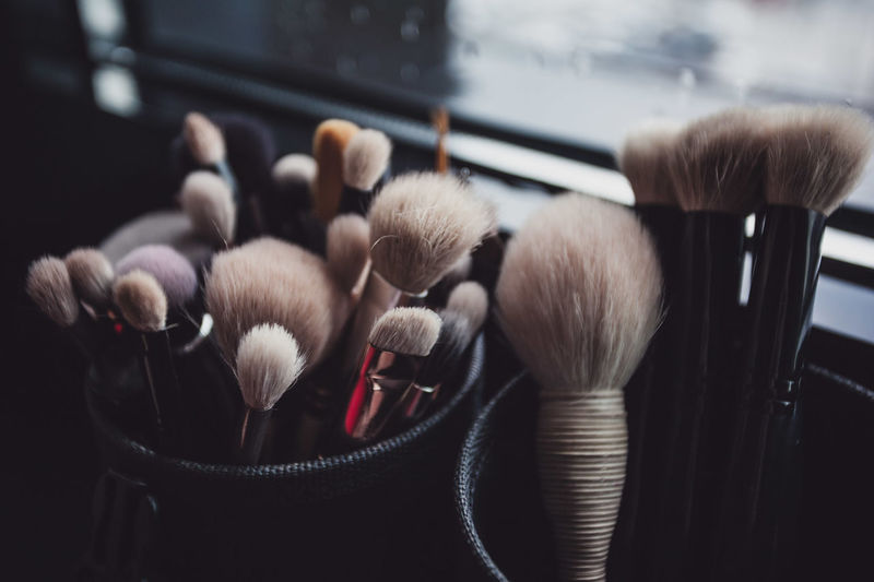 Make-up brushes in containers