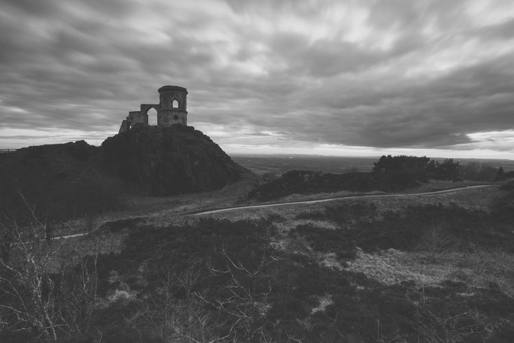 Mid distance view of mow cop castle against cloudy sky