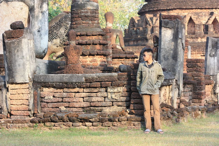 Full length of man standing against temple old ruins