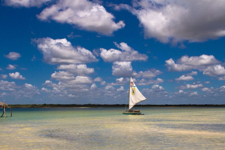 Sailboat Sailing Shallow Water Turquoise Turquoise Water Clouds And Sky Blue Sky White Sail Sail