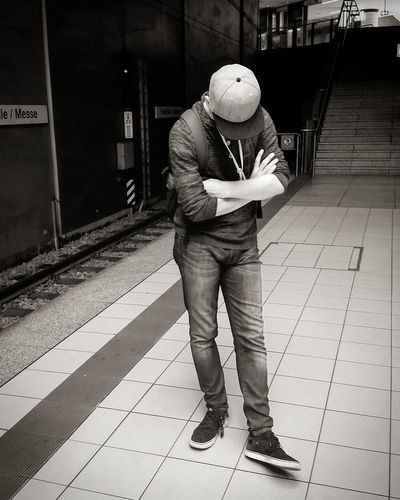 One Man Only One Person Only Men Full Length Headwear People Hardhat  Men Teenager Metro Metro Station City Pose Industry Indoors  Day EyeEmNewHere The Week On EyeEm Blackandwhite Bandw Undercover Hide Connected By Travel Black And White Friday EyeEm Ready   Fashion Stories