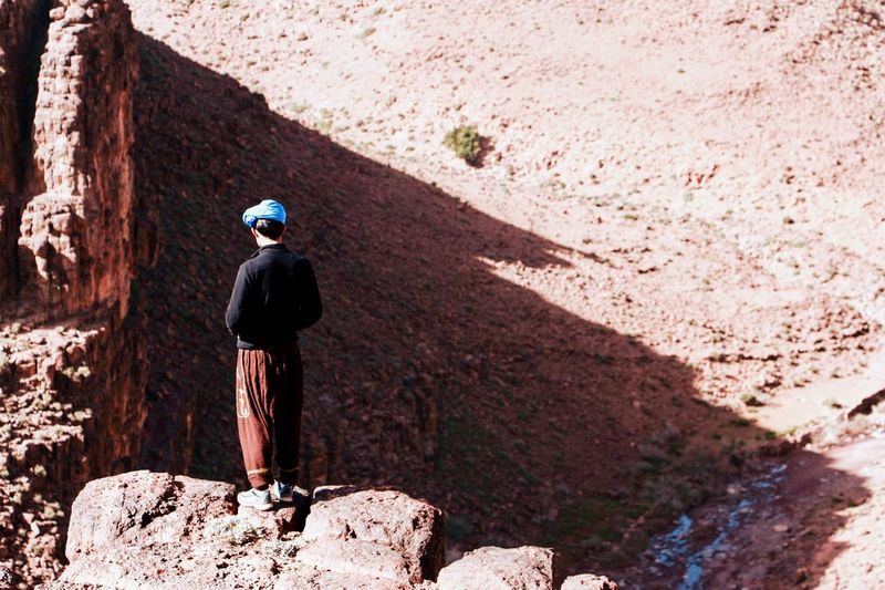 Full length rear view of man on rock