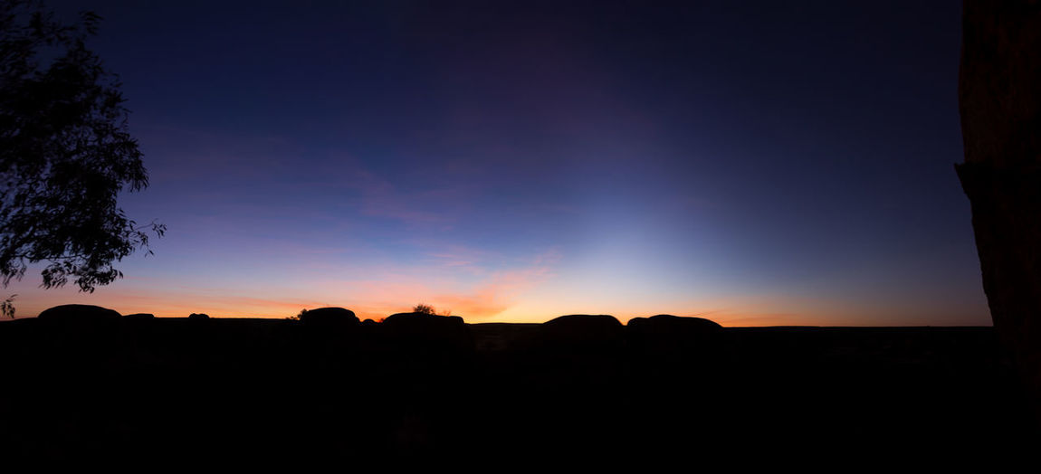 Sunrise at the Devils Marbles in the australian outback. Beauty In Nature Blue Sky Clear Sky Devils Marbles Early Morning First Light Landscape Nature No People Outdoors Rock - Object Rock Formation Scenics Silhouette Sky Starting The Day Sunrise Tranquil Scene Tranquility Tree