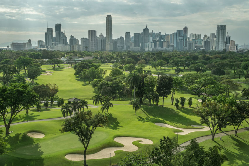 Adapted To The City Architecture City Cityscape Downtown District Golf Grass Green - Golf Course Skyscraper Urban Skyline Shades Of Green