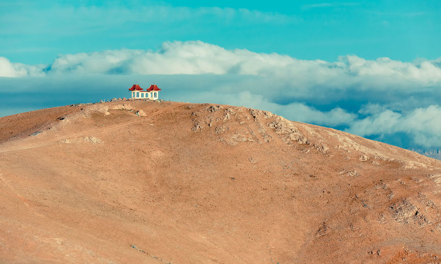 White house on the top of the hill Architecture Beauty In Nature Cloud - Sky Day High Hill House Mountain Nature Outdoors Peak Physical Geography Rock - Object Scenics Sky Top Tranquil Scene Tranquility