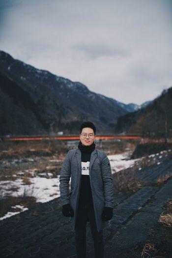 Portrait of man standing in snow