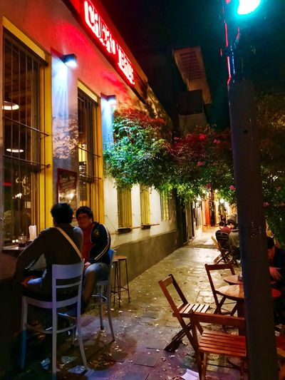 Thames street (Buenos Aires) Streetphotography Street At Night Bar Argentina Buenos Aires, Argentina  Buenos Aires Illuminated Night Two People Architecture Adult Real People Men Building Exterior Women Sitting Built Structure Seat Togetherness Lifestyles City Positive Emotion Young Adult