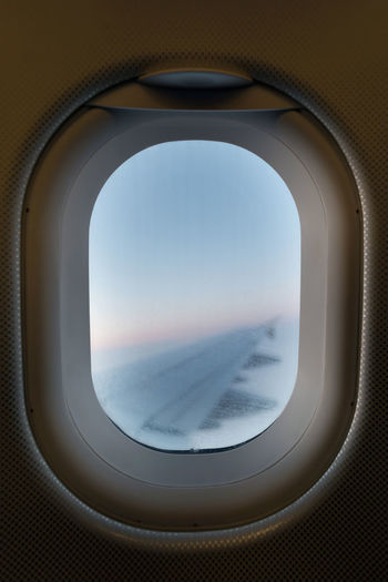 Looking out from an airplane window overlooking the airplane right wing Air Vehicle Aircraft Wing Airliner Airplane Cloud - Sky Commercial Airplane Flying Glass - Material Journey Mid-air Mode Of Transportation Motion No People Public Transportation Sky Transparent Transportation Travel Vehicle Interior Window