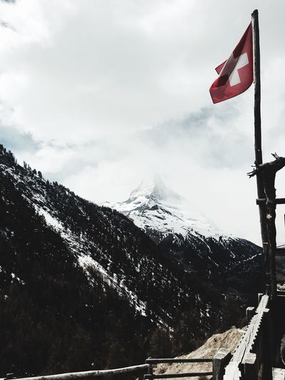 Zermatt 🏔 Mountain Flag Snow Cold Temperature Winter Sky Day Nature No People Snowcapped Mountain Outdoors Patriotism Mountain Range Low Angle View Scenics Beauty In Nature Close-up