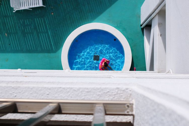 Directly above shot of woman in swimming by building
