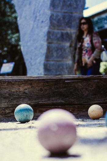 Bocci Bal Architecture Ball Casual Clothing Child Close-up Day Focus On Foreground Incidental People Leisure Activity Lifestyles Nature Outdoors People Playing Real People Selective Focus Sport Two People Women