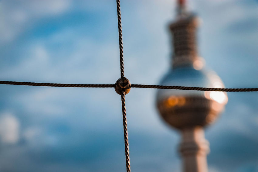 Alexanderplatz Berlin Berlin TV Tower Bokeh Cable Close-up Day Electricity  Low Angle View Metal Moody Sky Nature No People Outdoors Sky Sky And Clouds TV Tower Urban Water Wire Wire Fencing