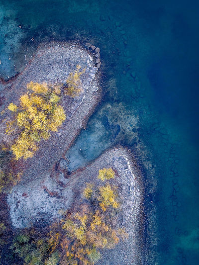 Perspectives On Nature Backgrounds Full Frame Textured  No People Multi Colored Day Water Outdoors Nature Tranquility Aerial Photography Drone  Switzerland Locarno Lake UnderSea Sea Nature Aerial View High Angle View Beach Rocks Tree Freshness Fresh On Market 2017