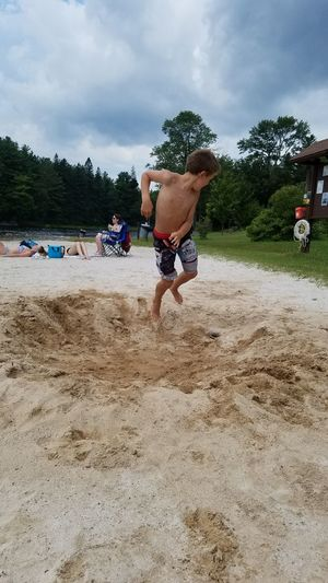 Catapulting over the crater EyeEm Selects Sportsman Men Shirtless Tree Sand Politics And Government Water Athlete Sky Swimming Trunks Beach Volleyball Volleyball - Sport Sprinting