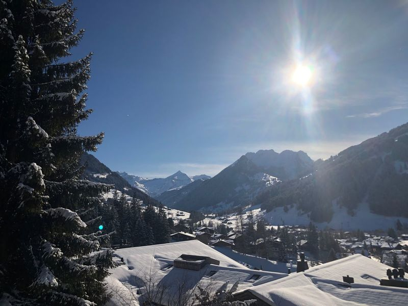 This afternoon Bolonie I❤️Gstaad Bolonie Style Bolonie Art Bokonie Snow Mountain Sunlight Winter Nature Outdoors Cold Temperature No People Sky Beauty In Nature Building Exterior Tree Architecture Scenics Day