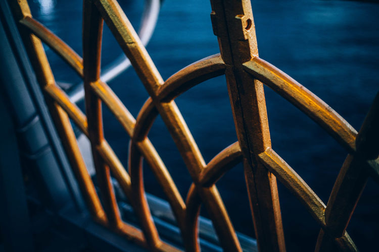 Close-up of metal fence by sea