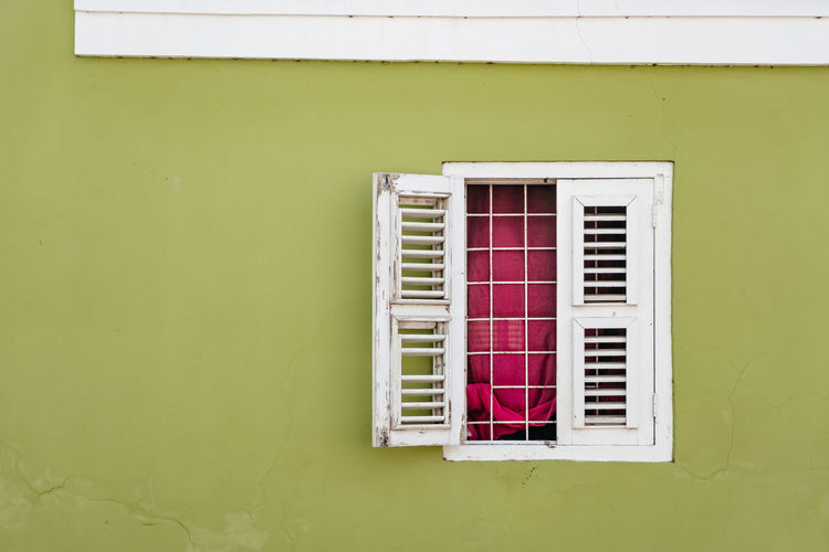 Window on white wall of house