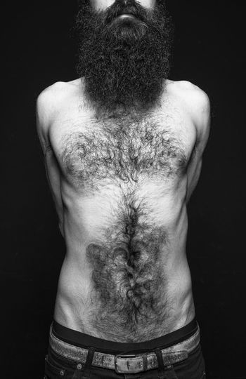Shirtless Man Against Black Background